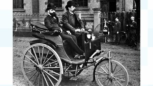 Karl Benz makes his first test run in Germany, October 1885 with the world's first car powered by a gas combustion engine.
