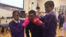 The boxer spent time with pupils and staff at Eastwood Community School in Keighley.