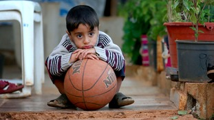 A Syrian refugee child at a settlement camp.