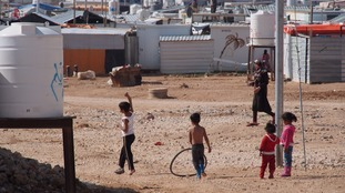 Syrian refugee children playing at a settlement camp.