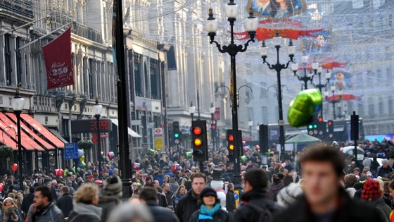 Christmas shoppers pack Regents Street.