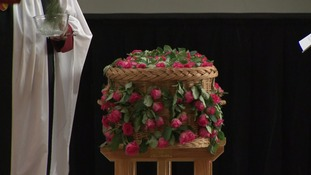 Saffie's wicker coffin was covered in roses.