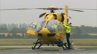 Prince William prepares for a flight with the air ambulance.