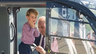 Prince George was given a tour of a helicopter by his father when the family were in Germany.