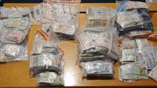Cigarettes and cash seized in loyalist paramilitary probe