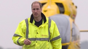 Prince William walks away from an air ambulance