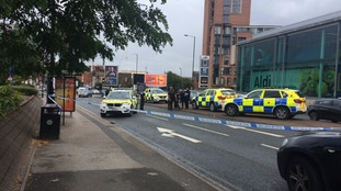 Police cordon off Tib Street in Manchester City Centre.