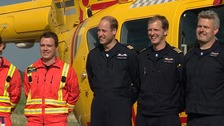 Prince William poses for photographers as he starts his last shift