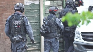 Armed police at the scene on Tuesday