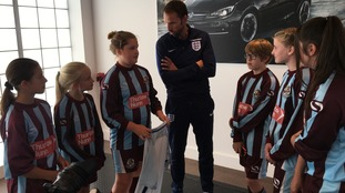 England head coach Gareth Southgate meeting members of the Woburn & Wavendon U12 Lionesses football team in Milton Keynes today.
