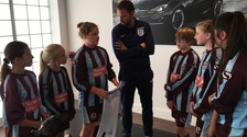 England head coach Gareth Southgate meeting members of the Woburn & Wavendon U12 Lionesses football team in Milton Keynes today.