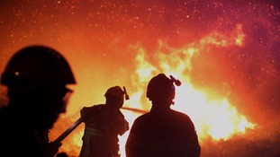 Hundreds of firefighters have been battling blazes such as this one, near the village of Biguglia, Corsica island