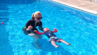 woman and infant in swimming pool