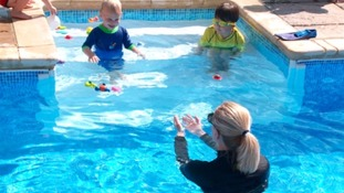 children and woman in the pool