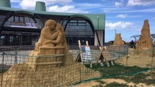 Tide turns for condemned sand sculptures