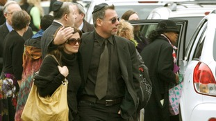Mourners leave a funeral service for Noah Pozner, the youngest victim of the Sandy Hook Elementary School shooting