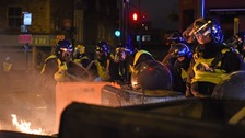 Protesters clash with police over Rashan Charles death