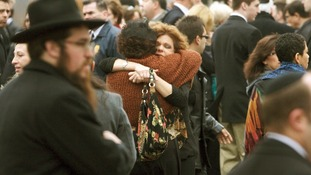 Veronique Pozner is hugged after the funeral services for her son Noah Pozner,