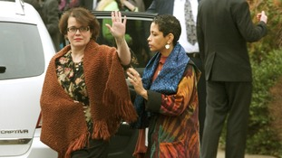 Noah Pozner's mother Veronique waves after the funeral services for her son