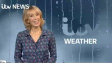 Emma Jesson in front of headline weather graphic