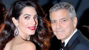 George Clooney threatens to sue over twins' photos