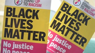 Protesters held 'black lives matter' placards.