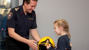 Chief Officer John Bonney presents Alan Bannon's Meritorious Medal for Gallantry to Alan's daughter Abi