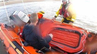 This is the moment a man was rescued from a toy dinghy, a mile off the coast of Redcar.