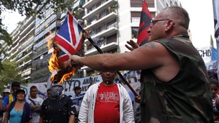 Protesters burn the British flag in Buenos Aires.