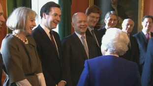 The Queen jokes with members of Cabinet ahead of the meeting