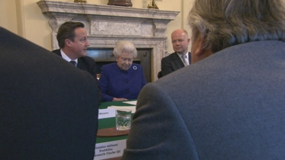 The Queen sat between the Prime Minister and Foreign Secretary