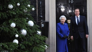 David Cameron greets the Queen on the steps of Number 10