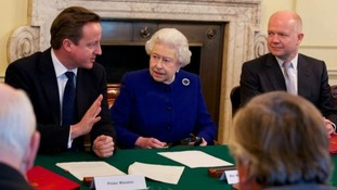 The Queen listens to David Cameron as he addresses Cabinet