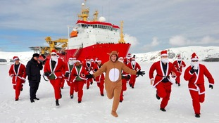 Crew members of HMS Protector start their ice run