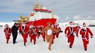 Crew members of HMS Protector start their ice run
