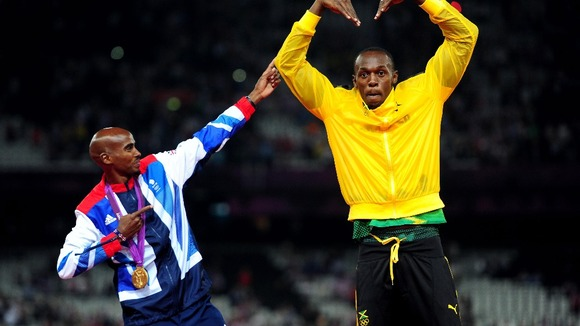 Mo Farah and Usain Bolt mimic each other&#x27;s famous victory celebrations.