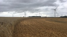Wind turbines under a cloudy sky