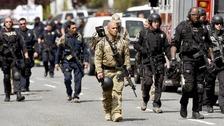 Law enforcement officers leave Oikos University