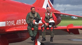 Red Arrows sit on the side of a plane
