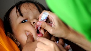 A child is vaccinated against polio.