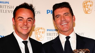 Anthony McPartlin (left) and Simon Cowell who has backed the presenter to make a full recovery.