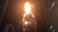 The Torch tower is engulfed by flames.