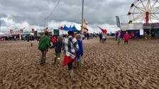 A family walks through a outdoor festival