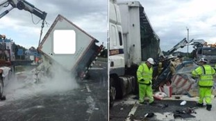 An overturned lorry has spilled flour between J14 and J15