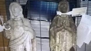 Missing graveside statues
