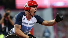 Great Britain's David Weir pumps his fist after winning gold in the men's 1500m T54 final