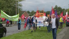 A protest has been held against proposals for the planned merger of Burton Hospitals and Derby Teaching Hospitals.