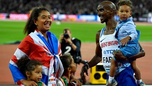 Mo Farah celebrates with his family after winning the 10,000m.