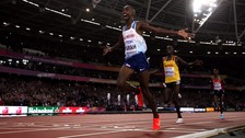 Mo Farah crosses the finish line in first place in the 10,000m.