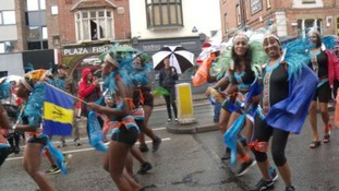 Rain fails to dampen spirits of carnival-goers